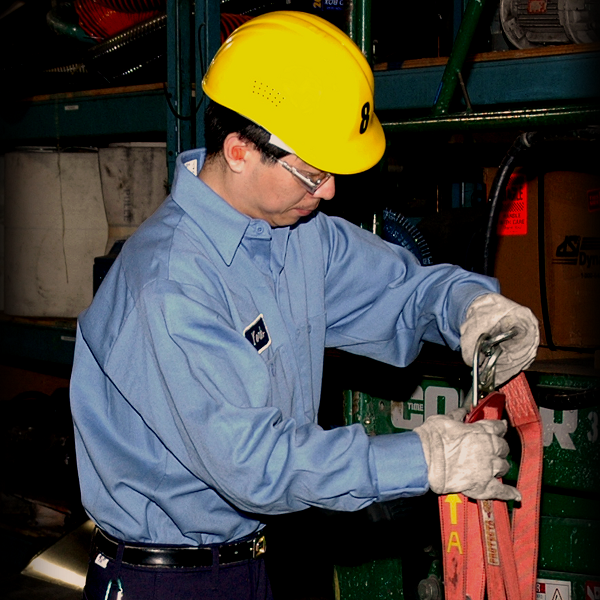 Worker with fall arrest harness