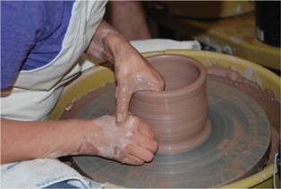 Throwing pots on the wheel