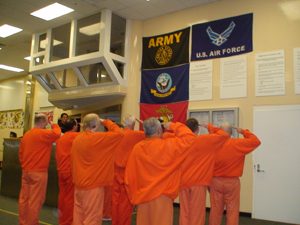 COVER Inmates saluting