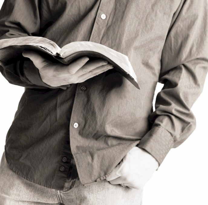 Man Standing Reading Bible (BW)