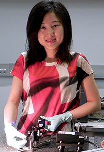 MIT graduate student Chi (Alice) Lu in the laser lab where she tests her flexible polymer probe. Photo: Denis Paiste, Materials Processing Center
