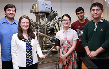 Members of the Laboratory for Electrochemical Interfaces at MIT include, from left,  Postdoctoral Associate Mostafa Youssef, Associate Professor of Nuclear Science and Engineering Bilge Yildiz, and graduate students Lixin Sun, Aravind Krishnamoorthy and Qiyang Lu. Photo: Denis Paiste, Materials Processing Center