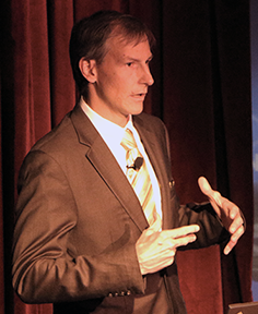 Lockheed Martin Fellow Slade Gardner describes improvements in production, design and cost in making parts for air and spacecraft during Materials Day Symposium, Oct. 21, 2014 at MIT.