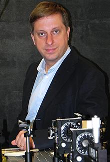 Physics Professor Marin Soljacic in his optics lab. Photo: Denis Paiste, Materials Processing Center