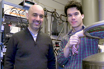 Physics Professor Raymond C. Ashoori, left, and Postdoctoral Associate Benjamin M. Hunt in an MIT lab where a dilution refrigerator is used to study electrical charges and conductivity of materials at very low temperatures.