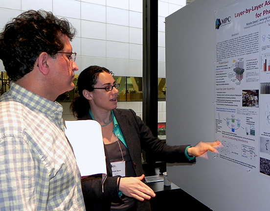 Nicole Davis, a chemistry graduate student, explains her poster on