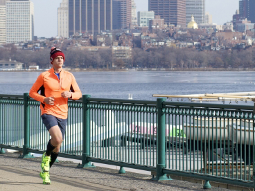 Graduate student Joseph Azzarelli running along the Charles River at MIT. A