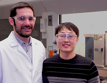 MIT Postdoctoral Associates Guillaume Lambotte, left, and Sang-Kwon Lee work together on high temperature molten electrolysis methods for extracting metals such as steel and copper.