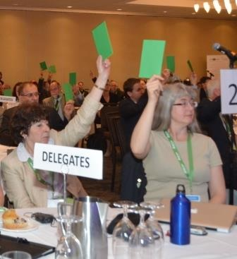 Hazel Corcoran (the CWCF delegate) and Lynn Hannley (the CoopZone delegate) voting in favour of CCA's unity resolution, on June 28th.