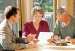 older couple in home with advisor