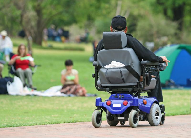 Man in power wheelchair