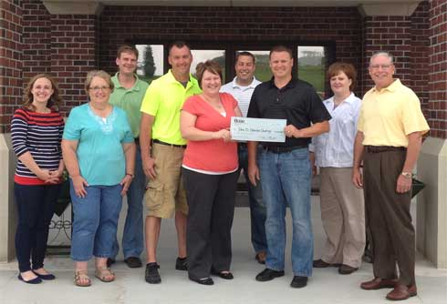 Base® presents Check to J.D.Gomke Charity