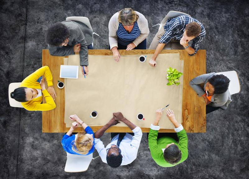 Multi-Ethnic Group of People in a Meeting and Copy Space