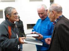 congregation handing out bibles