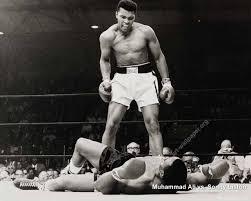 Ali standing