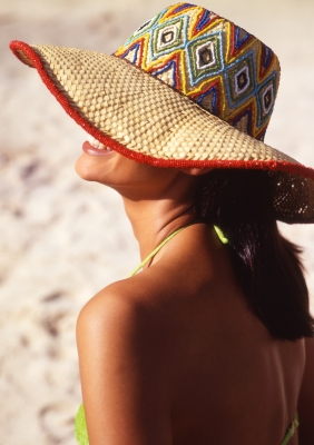 woman on beach with hat