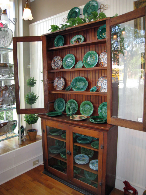 Cabinet full of antique Majolica and Imari