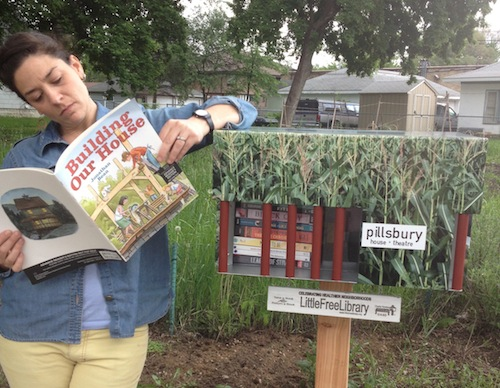 UA Executive Director Julie Guidry visiting a Little Free Library