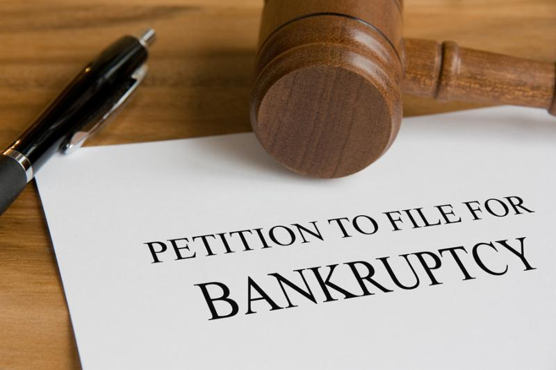Bankruptcy concept with judge s wooden gavel and petition notice