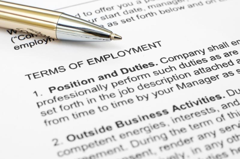 Close up of pen on employment contract