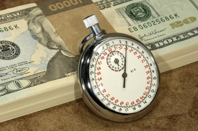 Stopwatch and Money - Hourly Wages Concept