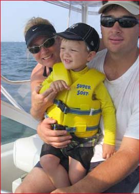 Cameron with his parents on a boat to see pop.