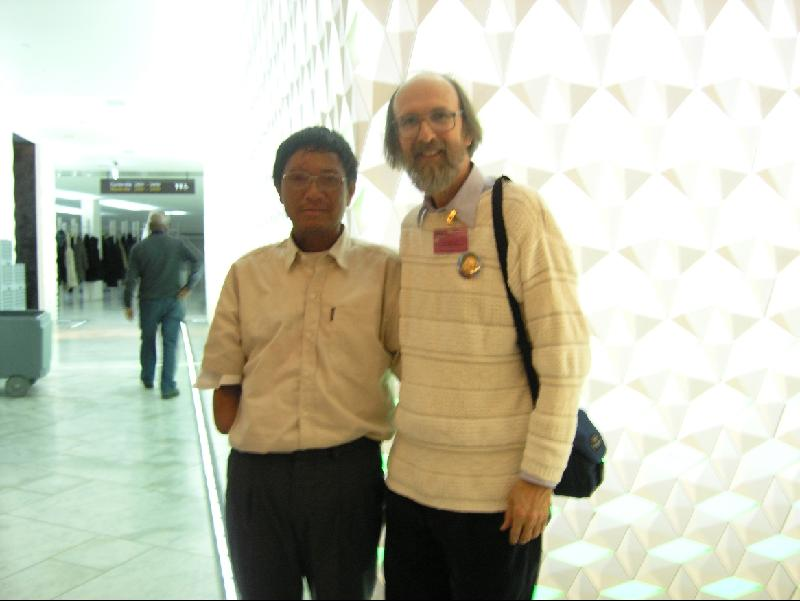 Oslo, Norway: Ta Douangcham, ban advocate from Khammouan, Province, Laos and Titus Peachey of Mennonite Central Committee at the International Convention on Cluster Munitions Treaty signing to ban cluster bombs (Dec 2009).