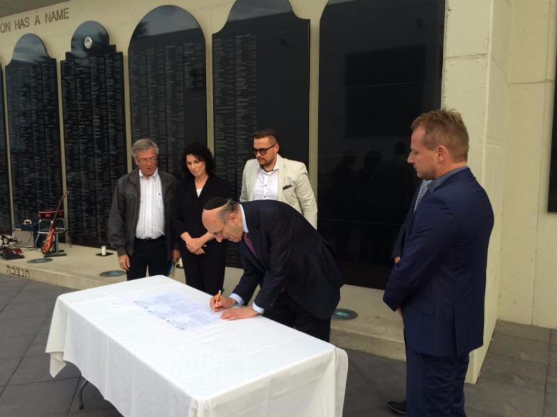 Mr. Emil Fish signs the Memorandum between UZZNO and BJPC