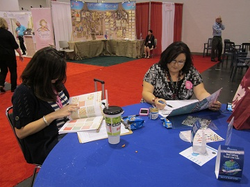 Cherie and Lynn writing orders