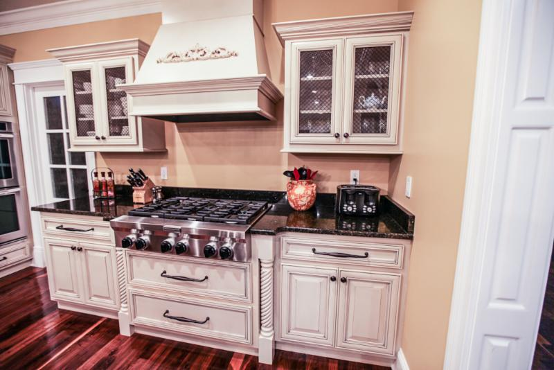 The Cook Top Area Features A Commercial Style Kitchenaid Gas Cook Top  Custom Wood Hood With Liner U0026 Blower, Accented With A Hand Carved Onlay.