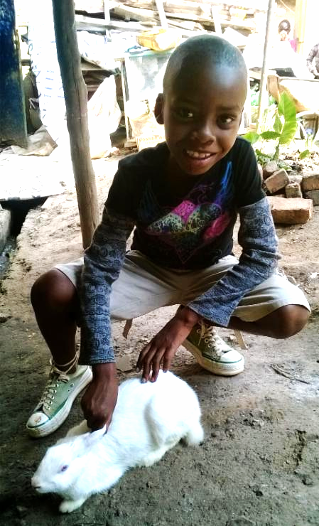 Christmas 2014 pictures! The sponsor bought him a rabbit.