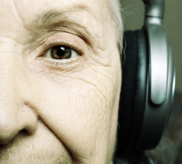 Elderly person listening to music