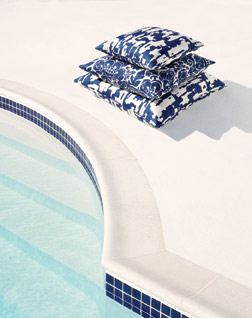 Pillows next to a swimming pool