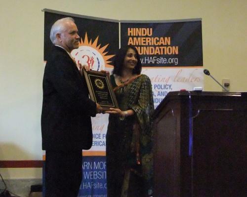 Patrick receiveing Gandhi Award