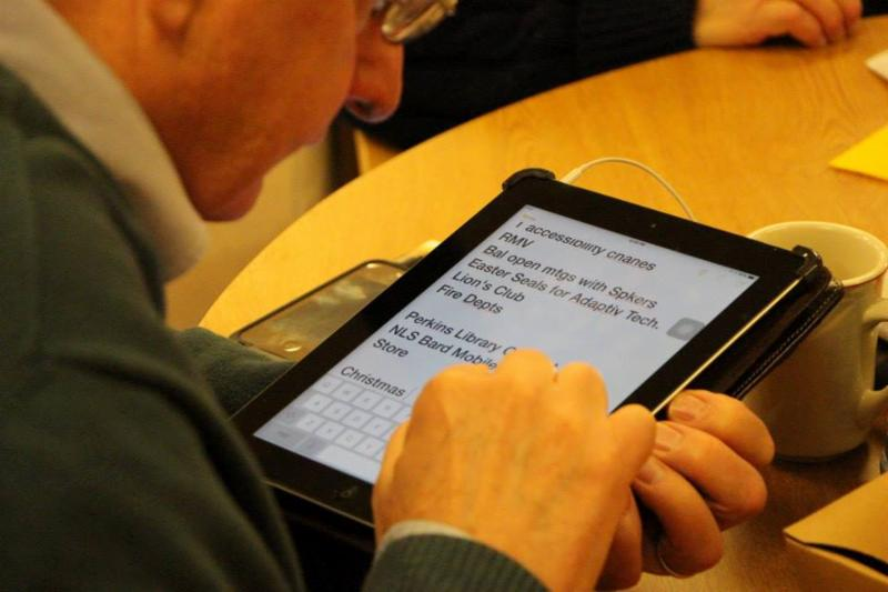 Visually impaired man uses an iPad