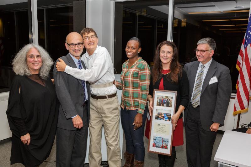 Representatives from Spaulding receive Community Partner Award from Barbara Salisbury and Zack