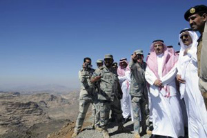 Saudi Arabian Prince Khaled Al Faisal (third from right) surveys the southern province of Jizan, near the border with Yemen, in November 2009.