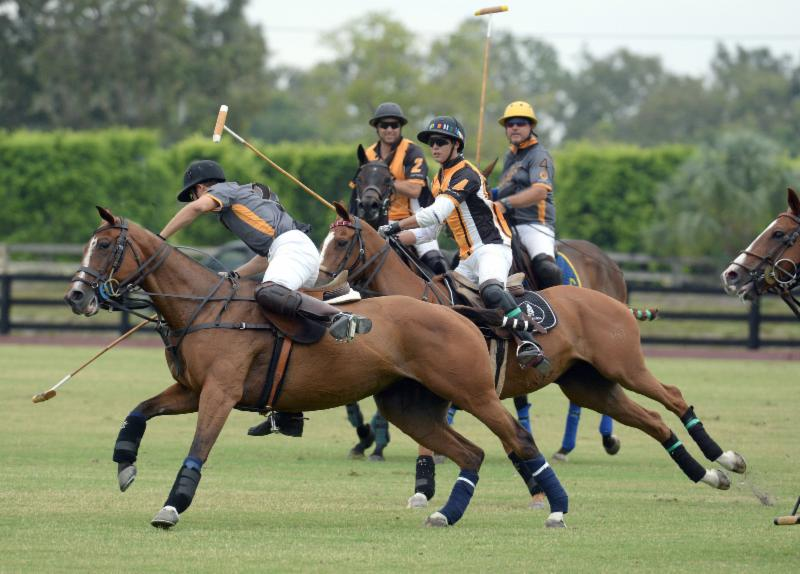 Alejandro Gonzales (2) of Polo Gear maintains possession of the ball with d