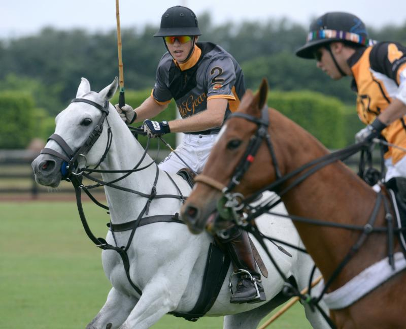 Alejandro Gonzales (2) of Polo Gear defends Carlitos Gracida (4) of Palm Be