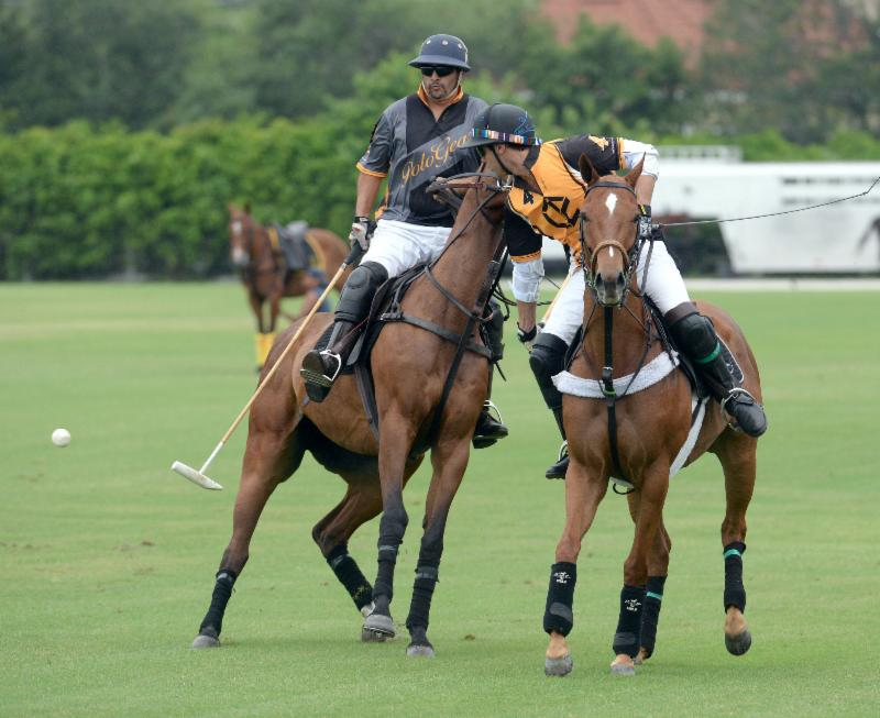 Carlitos Gracida (4) of Palm Beach Polo defends Guille Aguero of Polo Gear