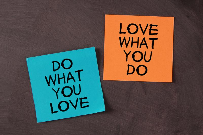 Love What You Do and Do What You Love  notes pasted on blackboard.