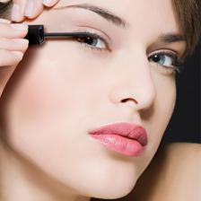 Girl putting on eyeliner