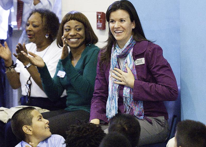 Kelly gets the surprise news/Photo credit: Milken Family Foundation