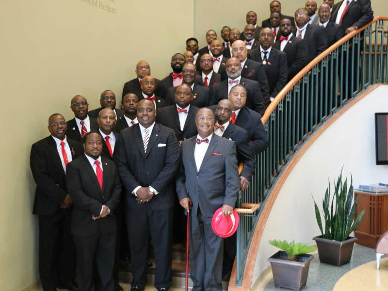 Members of Kappa Alpha Psi fraternity on the steps of the Jackie Gaughan Multicultural Center